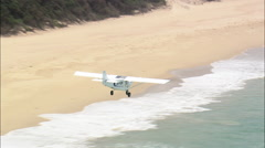 AERIAL South Africa-Microlight Flying Over Shoreline - stock footage