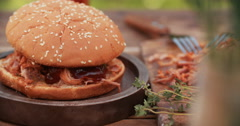 Finishing touch going into a pulled pork burger Stock Footage