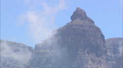 AERIAL South Africa-Fast Flight Up To Cathedral Peak Summit Stock Footage