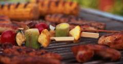 Tender chicken fillets, corn and sausages grilling on a barbecue Stock Footage