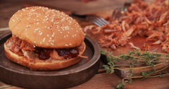 Pulled pork burger having a toothpick pushed through Stock Footage