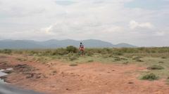 Samburu tribal man on bicycle in savannah, Kenya, Africa Stock Footage