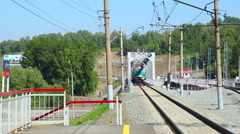 Suburban train arrive at the suburb station Stock Footage