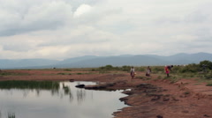 Stock Video Footage of Women collect polluted water from puddle, Samburu, Kenya, Africa