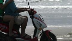 People Ride a Scooter On the Beach Arkistovideo