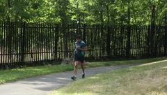 Runner running in park (no grade) Stock Footage