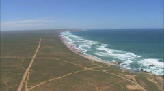 AERIAL South Africa-Low Over Beach With Red Sand Stock Footage