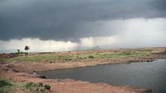 Big rain storm crossing the savannah, Samburu, Kenya, Africa Stock Footage