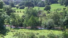 River Barle running through Somerset Fields and Countryside in Exmoor Nationa Stock Footage