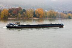 Loaded barge navigating river Rhine Germany Stock Photos