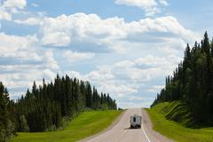 RV drives Alcan south Fort Nelson BC Canada - stock photo