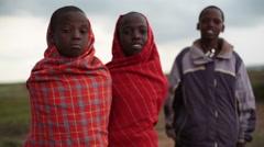 3 traditional Samburu children smile, Kenya, Africa, medium shot Stock Footage