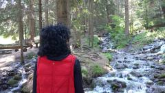 Hiking girl enjoy snow melting mountain spring flowing waters. UHD 4K steadyc Stock Footage