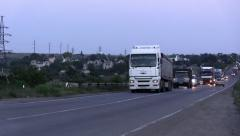 A convoy of cars moving on the bridge Stock Footage