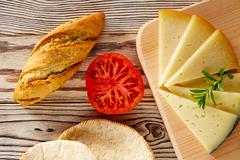 Mediterranean food bread loaf tomato and cheese Stock Photos