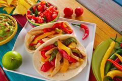 Chicken fajitas tacos mexican food guacamole chili Stock Photos