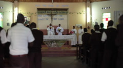 Priest, alter boys and boarding school boys sing in church mass, Kenya, Africa - stock footage