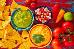 Mexican food nachos guacamole pico gallo cheese - stock photo