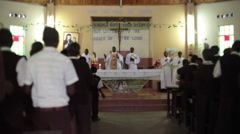 Boarding school boys and priests sing in church mass, Kenya, Africa - stock footage