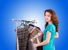 Woman trying new clothing against gradient Stock Photos