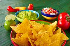Mexican food nachos guacamole pico gallo chili - stock photo