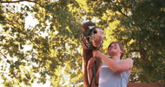 Healthy horse with a smiling girl in a sunny park Stock Footage