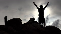 Silhouetted Triumphant Man Punches Air With Fists Stock Footage