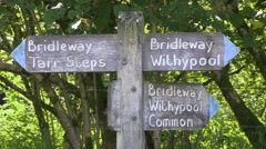 Wooden Bridle Way Sign to Tarr Steps Withypool Common in Exmoor National Park - stock footage