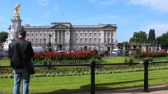 Stock Video Footage of Buckingham Palace and Victoria Memorial and  crowed of visitors around them
