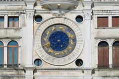 Exteriror detail of the Clock Tower in Venice, Italy. - stock photo