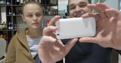 Lovely couple in cafe making selfie Stock Footage