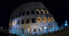 Selfie of tourists against Coliseum at night Stock Footage