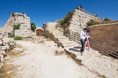 Tourists visit Ajloun fortress in Ajloun, Jordan. Stock Photos