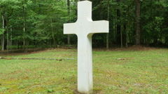 3900 White Stone Cross in Forest Next to Tombstone, 4K Stock Footage