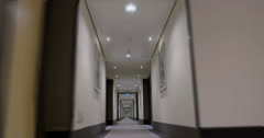 Timelapse of moving forward in empty light hotel corridor - stock footage