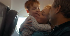 Boy and his grandmother hugging in the plane Stock Footage