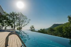 Stock Photo of Infinity pool on the bright summer day