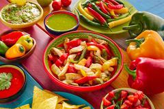 Chicken fajitas mexican guacamole pico gallo chili - stock photo