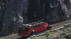 AERIAL United States-Glacier Park 'Red Jammer' Bus Tours Stock Footage