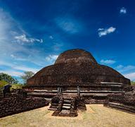 Ancient Buddhist dagoba (stupe) Pabula Vihara. Ancient city of Pollonaruwa, S Stock Photos