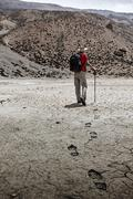Single mountaineer trekker walking in Himalayas mountains ecotourism concept  - stock photo