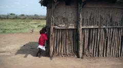 Samburu house with child next to it, Kenya, Africa Stock Footage