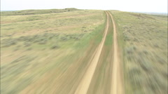 AERIAL United States-Flight Low And Fast Down Dirt Road Stock Footage