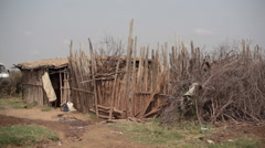 Children next to rural hut mud house, Samburu, Kenya, Africa Stock Footage