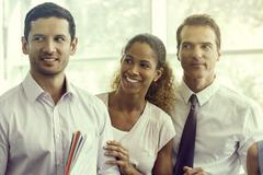 Business associates sharing lighthearted moment together - stock photo