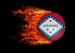 US state flag with a trail of fire - Arkansas - stock photo