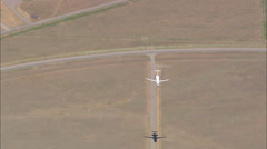 AERIAL United States-Flight With Jet Landing At Bozeman Airport - stock footage