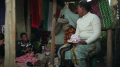 Women make crafts for sale in market, Samburu, Kenya, Africa Stock Footage