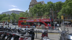 Barcelona City Tour bus parked in Plaza de Catalunya Stock Footage