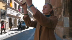 Woman making photos of European architecture - stock footage